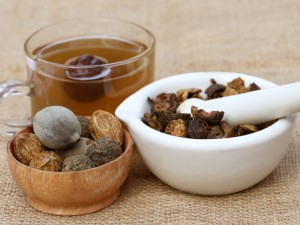 Tea made from Triphala, a combination of ayurvedic fruits with mortar and pestle